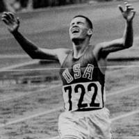 Run for the ages: American Billy Mills crosses the finish line to win the 10,000 meters at the 1964 Tokyo Olympics. He ran the race 45 seconds faster than he ever had to claim the gold. | AP