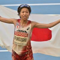 From Russia with love: Kayoko Fukushi celebrates after winning the bronze medal in the women's marathon at the World Athletics Championships in Moscow on Saturday. | AP