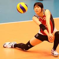 Total concentration: Japan's Risa Shinnabe prepares to dig the ball against Bulgaria in the FIVB World Grand Prix on Friday in Sendai. | FIVB