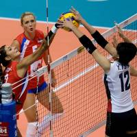 Ball control: Serbia's Jovana Brakocevic (left) and Japan's Yuki Ishii (12) and Aimi Kawashima compete for a point in the FIVB Women's World Grand Prix Finals on Friday in Sapporo. Serbia defeated Japan 25-22, 25-17, 25-19.   FIVB