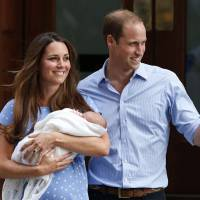 Middle-class heroes: The Duke and Duchess of Cambridge hold their son, Prince George of Cambridge, outside a London hospital on July 23, a day after his birth. The royal couple's seemingly down-to-earth lifestyle has won them many fans.   AP