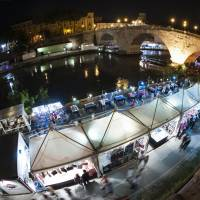 Added attraction: Temporary shops and cafes stand along the Tiber River during the happening 'Along the Tiber in Rome . . . A River of Culture' last month in central Rome. | AFP-JIJI