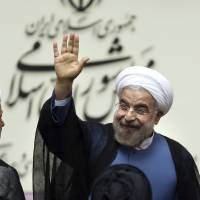 Shift in direction?: New Iranian President Hasan Rouhani waves after his swearing in ceremony in Tehran on Sunday. | AP