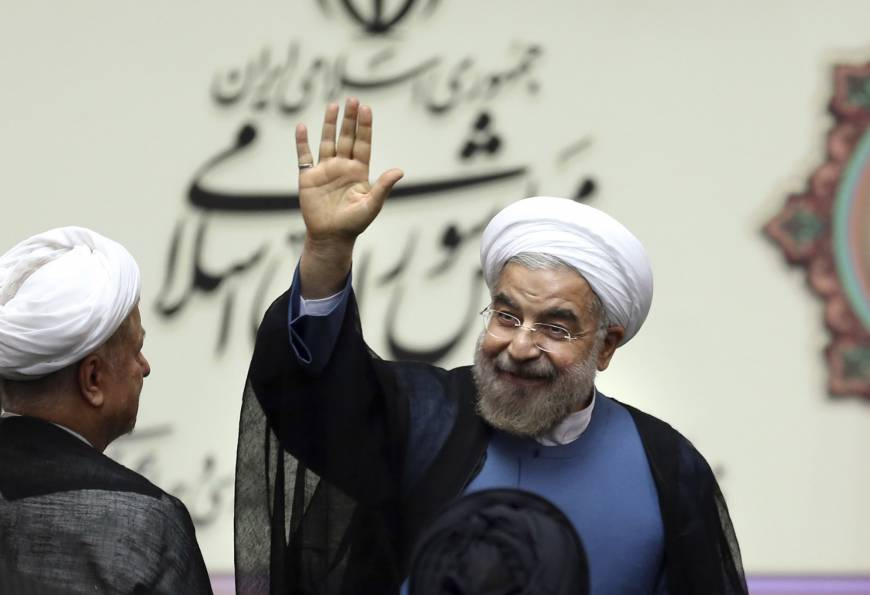 Iran's Rouhani sworn in as president, vows shift in relations with West