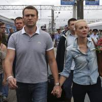 Populist: Russian opposition leader and Moscow mayoral candidate Alexei Navalny arrives in the capital on July 20 with his wife Yulia. On July 19 he was unexpectedly released from jail despite being sentenced to five years in prison just a day earlier. | AP