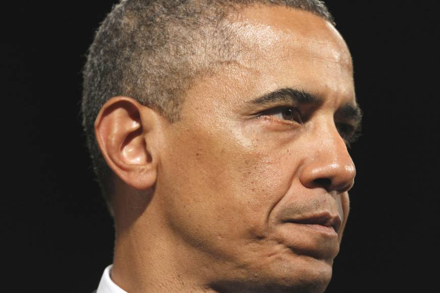 For Obama, racial progress tied to economic woes