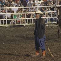 Masking the truth?: A rodeo clown wearing a mask of President Barack Obama is propped up like a straw man with the appearance that a broom stick is going up his backside at the Missouri State Fair in Sedalia on Aug. 10. | AP