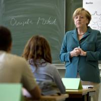 Speech lesson: German Chancellor Angela Merkel begins a lecture on the building of the Berlin  Wall to a 12th-grade class during her visit to a secondary school in Berlin on Aug. 13. | AP