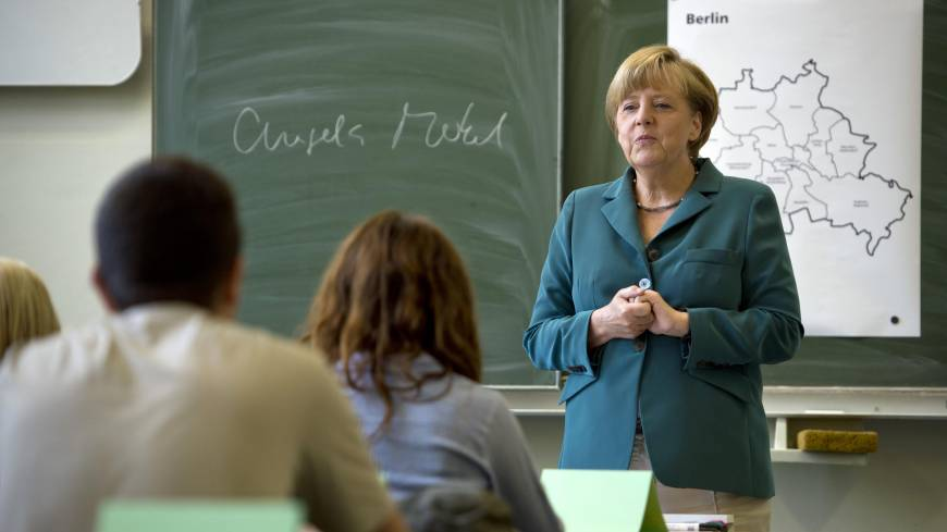 Speech lesson: German Chancellor Angela Merkel begins a lecture on the building of the Berlin  Wall to a 12th-grade class during her visit to a secondary school in Berlin on Aug. 13.