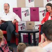 The soft sell:  The Social Democratic Party's candidate for chancellor, Peer Steinbrueck, and his wife, Gertrud, read a chapter from the children's book 'Jim Knopf' during the Deutschlandfest, which was organized by the SDP in Berlin on Sunday. | AFP-JIJI