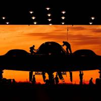 Waiting in the wings: Hangar crew work on a B-2 stealth bomber at  Whiteman Air Force Base in Missouri City,  Texas, in May.   AFP-JIJI