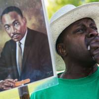 Slow march to parity: A man weeps during the commemoration of the 50th anniversary of the March on  Washington at the National Civil Rights Museum in Memphis,  Tennessee, on  Wednesday. | AP
