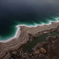 Changing scenery: Sinkholes created by the evaporation of the Dead Sea dot the Israeli coast near Kibbutz Ein Gedi. | AFP-JIJI