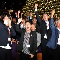 Euphoria: (From left) Olympic medal winners Ai Shibata and  Saori Yoshida  pump their fists in the air along with alpinist Yuichiro Miura at The Tokyo Chamber of Commerce and Industry in Marunochi, Tokyo, at the moment when the IOC announced the host city of the 2020 Summer Olympics. | YOSHIAKI MIURA