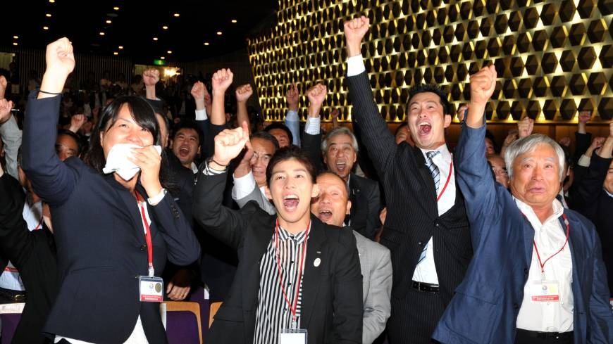 Euphoria: (From left) Olympic medal winners Ai Shibata and  Saori Yoshida  pump their fists in the air along with alpinist Yuichiro Miura at The Tokyo Chamber of Commerce and Industry in Marunochi, Tokyo, at the moment when the IOC announced the host city of the 2020 Summer Olympics.   YOSHIAKI MIURA