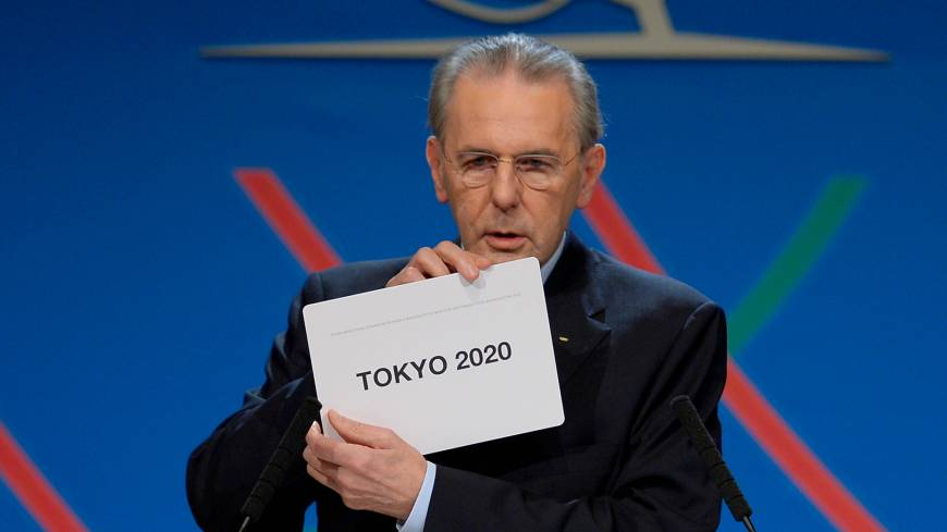 International Olympic Committee President Jacques Rogge shows a card displaying Tokyo, the city  chosen to host the 2020 Summer Olympics, in Buenos Aires, Saturday.   AP