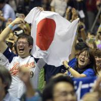 Supporters cheer at Tokyo's Komazawa Gymnasium, one of the sites of the 1964 Tokyo Olympics. | KYODO