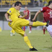 Coming at you: Reysol's Cleo takes a shot during Kashiwa's Asian Champions League match against Guangzhou on Wednesday. Guangzhou won 4-1.  | KYODO