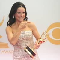 Julia Louis-Dreyfus holds her Emmy Award for lead actress in a comedy series for her role in 'Veep' at the Emmy Awards in Los Angeles, California.   | AFP-Jiji