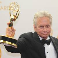 Michael Douglas celebrates winning Best Actor in a Miniseries/Movie for playing Liberace in 'Behind the Candelabra' at the 65th Annual Primetime Emmy Awards. | AFP-Jiji