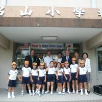 People-to-people exchanges: Mutsumi Katayama (far right) has annually organized and attended the Japan tours offered for American teachers selected as California Teachers of the Year (CTOY). The CTOY 2012 teachers visit Meizan Elementary School in Kagoshima Prefecture on July 5, 2012, during their tour of Japan.  |  COURTESY OF MUTSUMI KATAYAMA
