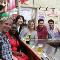 People-to-people exchanges: Mutsumi Katayama (third from left) has annually organized and attended the Japan tours offered for American teachers selected as California Teachers of the Year (CTOY). The CTOY 2013 teachers enjoy 'okonomiyaki' (Japanese savory pancake) at Okonomimura in Hiroshima on June 29, during their tour of Japan.  | COURTESY OF MUTSUMI KATAYAMA