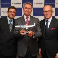 Left to right: Sakari Romu, Finnair sales director of Japan, Klaus W. Heinemann, Finnair chairman, and Pekka Vauramo, Finnair president and CEO, in Tokyo on Sept. 24. | YOSHIAKI MIURA
