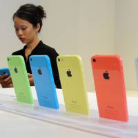 HighPhone: The new, lower-cost iPhone 5C debuted in a series of lively colors at an event at Apple Inc.'s headquarters in Cupertino, California, on Tuesday. Consumers in China are complaining that at a local retail price of more than $700, the device is still well out of their reach. | AFP-JIJI