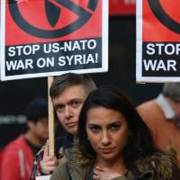Opposed: Australians protest military action against Syria in Sydney on Friday. | AFP-JIJI