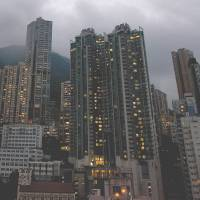 False picture: Despite its glamorous high-rises, about 20 percent of Hong Kong's residents are living below the poverty line. | AFP-JIJI