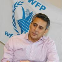 Dodging bullets: Muhannad Hadi, a U.N. World Food Program emergency coordinator for Syria, speaks on the situation in the war-torn country Friday at the Japan National Press Club in Tokyo.  | KYODO