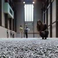 While Ai Weiwei's 'Sunflower Seeds,' an installation comprising millions of handcrafted porcelain seeds, is the latest. | BLOOMBERG