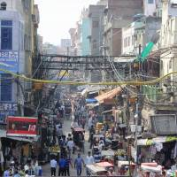 In a jam: In Old Delhi, streets are so narrow and crowded that car traffic is nearly impossible — and yet India's population of 1.27 billion is expected to put an extra 380 million cars on the road over the next two decades.   NOZOMU KAWASHIMA