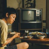 Like father, like son: Toma (Masaki Suda) lives with his father (Ken Mitsuishi) — and learns from him a habit of sexual violence. | © Tanaka Shinya/Kodansha 2013 'Tomogui' Seisaku Iinkai
