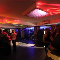A club reborn: Preparing for a music video shoot in 911 Black, Gilbert Otaigbe's nightclub in Abuja.  Use of the club was offered free of charge in hopes that the video would attract customers. | TOM SAATER