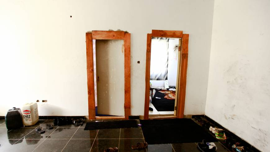 Work in progress: Outside two rooms where Gilbert Otaigbe houses club employees, in the Maitama district of Abuja.   TOM SAATER