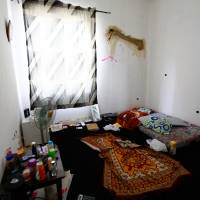 Half-way house: Inside one of two rooms where Gilbert houses club employees, in the Maitama district of Abuja.   TOM SAATER