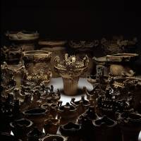 Otherworldly gathering: A wondrous trove of Jomon pots from the Sasayama site in Niigata Prefecture that Ogawa has arranged and lit so 'people sit up and take notice.' | TADAHIRO OGAWA