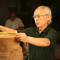 Heritage: Tadahiro Ogawa, seen at work in museums in Nagano Prefecture believes really good photos of Jomon artifacts can greatly help today's Japanese connect with their forebears. | EDAN CORKILL