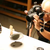 Heritage: Tadahiro Ogawa, seen at work in museums in Nagano Prefecture believes really good photos of Jomon artifacts can greatly help today's Japanese connect with their forebears.   EDAN CORKILL