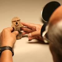 Heritage: Tadahiro Ogawa, seen at work in museums in Nagano Prefecture believes really good photos of Jomon artifacts can greatly help today's Japanese connect with their forebears.   .jpg