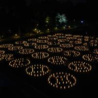 Lighting up the night: Candles wrapped in paper bear messages from residents of Tohoku that express sentiments about the 2011 Great East Japan Earthquake. The event is organized by Tama University's Maruyama Seminar.