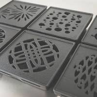 The grills of Kayariki's cast-iron mosquito-coil burners are based on traditional kimono patterns.