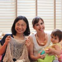 In stitches: Naoko Suzuki, owner of Sweetroom Daikanyama, with the author and her daughter Kiko during Knit Club, a knitting class for mothers. | DANIELLE DEMETRIOU