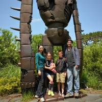 Photo op: The writer and family at the Ghibli Museum, in one of the few spots where pictures are allowed.
