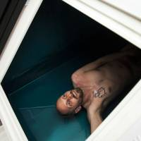 Taking the plunge: Journalist Justin Moyer gets ready for an hour of floating in a sensory-deprivation tank. This therapy is said to help people manage pain, battle depression and quit smoking. | THE WASHINGTON POST