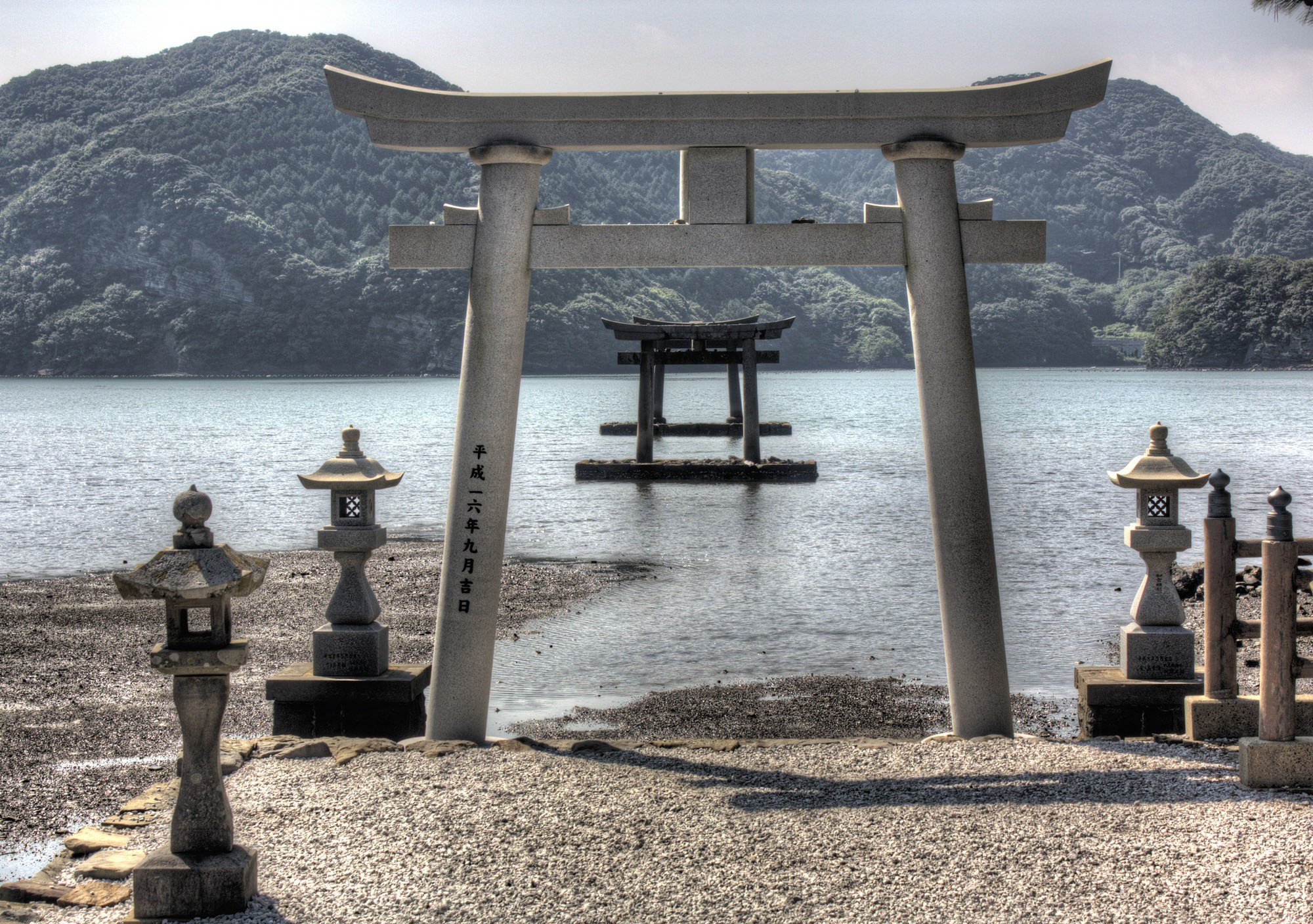 Island welcome: Two of the five torii gates at Watastumi Shrine appear as though floating in the water.   ALON ADIKA