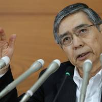 Setting policy: Bank of Japan Gov. Haruhiko Kuroda speaks during a news conference at BOJ headquarters in Tokyo on Aug. 8.   BLOOMBERG