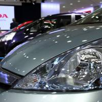 Fighting Fit: Honda Motor Co. Fit vehicles are displayed at the automakers Tokyo headquarters Thursday. | BLOOMBERG