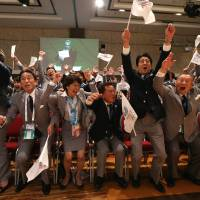 Prime Minister Shinzo Abe (third from right) celebrates alongside Tokyo 2020 delegation members as IOC president Jacques Rogge announces the Japanese capital as the winner of the bid to host the 2020 Summer Olympic Games, during the 125th session of the International Olympic Committee, in Buenos Aires on Sept. 7. | AFP-JIJI
